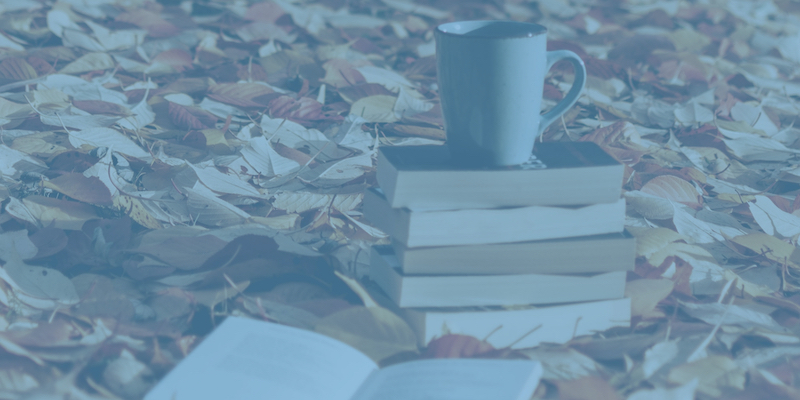 Books in leaves with a coffee cup